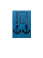 Load image into Gallery viewer, Two earrings hang on a blue earring card. The earrings are 3D printed in a plant based black filament. They are shaped like anchors.