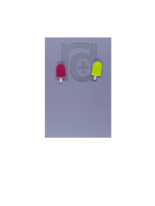 Two small and detailed R+D earrings are shown on a purple earring card. They are shaped as popsicles with white sticks. The earrings are mismatched, one popsicle is hot pink and one is bright yellow.