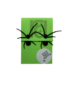 Load image into Gallery viewer, Two front back or jacket earrings are pictured on a bright green paper earring card. Each earring has two parts that are worn on each side of the earlobe. The effect is that these black long legged spiders will look as though they are crawling through your earlobe when you wear them. The front piece has two legs and the spider's head with little pinchers visible. The back piece has two more legs and a rounded black body.