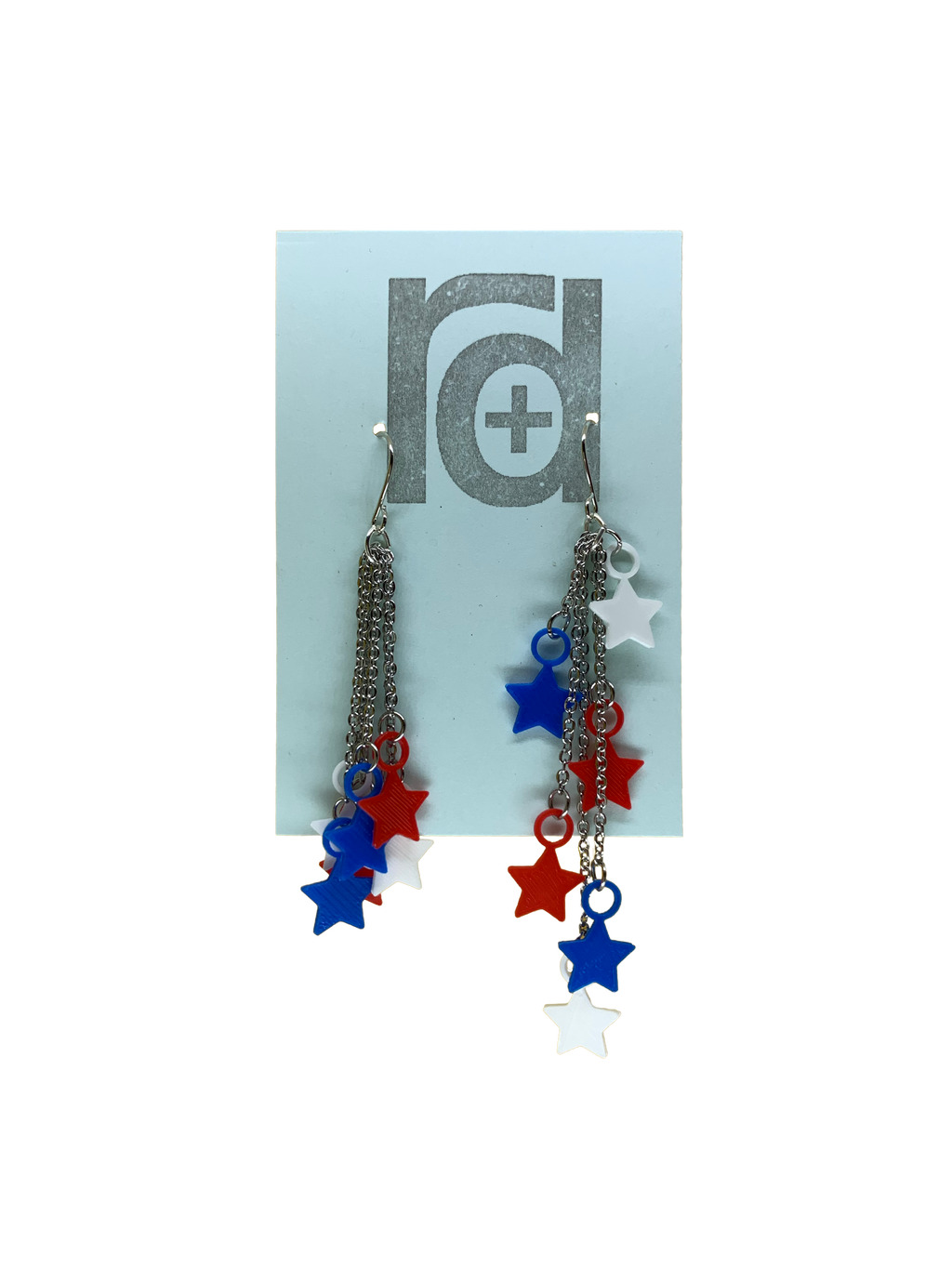 On a light blue earring card are two earrings. They have red, white, and blue stars that hang at the end of chains. The stars can be pulled to hang all at one length (shown on the left earring) or at various lengths (shown on the right earring).