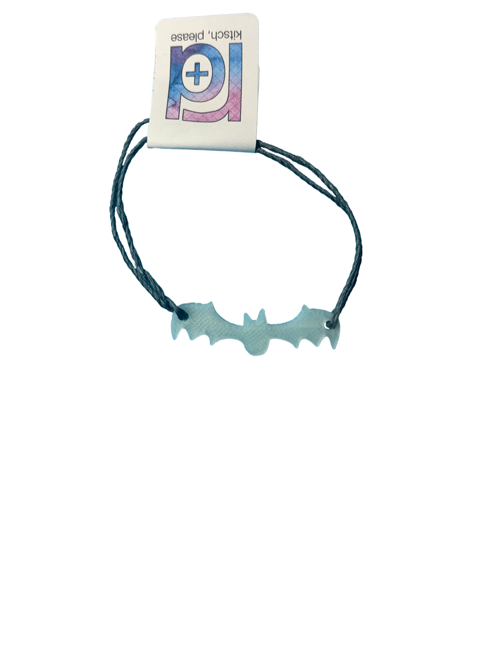 Pictured on a transparent background is a bracelet. There are two dark grey strands and they are holding on to a 3D printed bat that glows in the dark. Hidden by a R+D tag are the two adjustable knots.