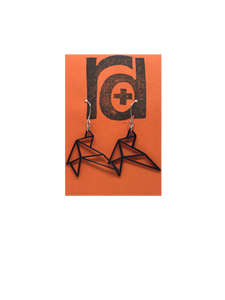 Shown on a bright orange earring card are two R+D earrings. They are geometric line shapes of birds flying. These sustainable 3D printed earrings are printed in black.