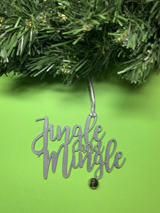 On a bright green background and hanging from a green wreath is a 3D printed R+D ornament. It is a cursive text with a jingle bell and covered in glitter to make it shimmer and shine in the light. This ornament reads, Jingle and Mingle.
