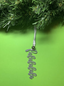 On a bright green background and hanging from a green wreath is a 3D printed R+D ornament. It is a cursive text with a jingle bell and covered in glitter to make it shimmer and shine in the light. This ornament reads, falalalala.