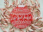 "Load image into Gallery viewer, On a white fabric background there are lots of red and white peppermint candy canes and a R+D 3D printed ornament. The ornament is shaped like a traditional bulb. It is bright red with white drawings and script on it. Worked into the doodles are the year 2020 and then the words, ""this year sucked""."
