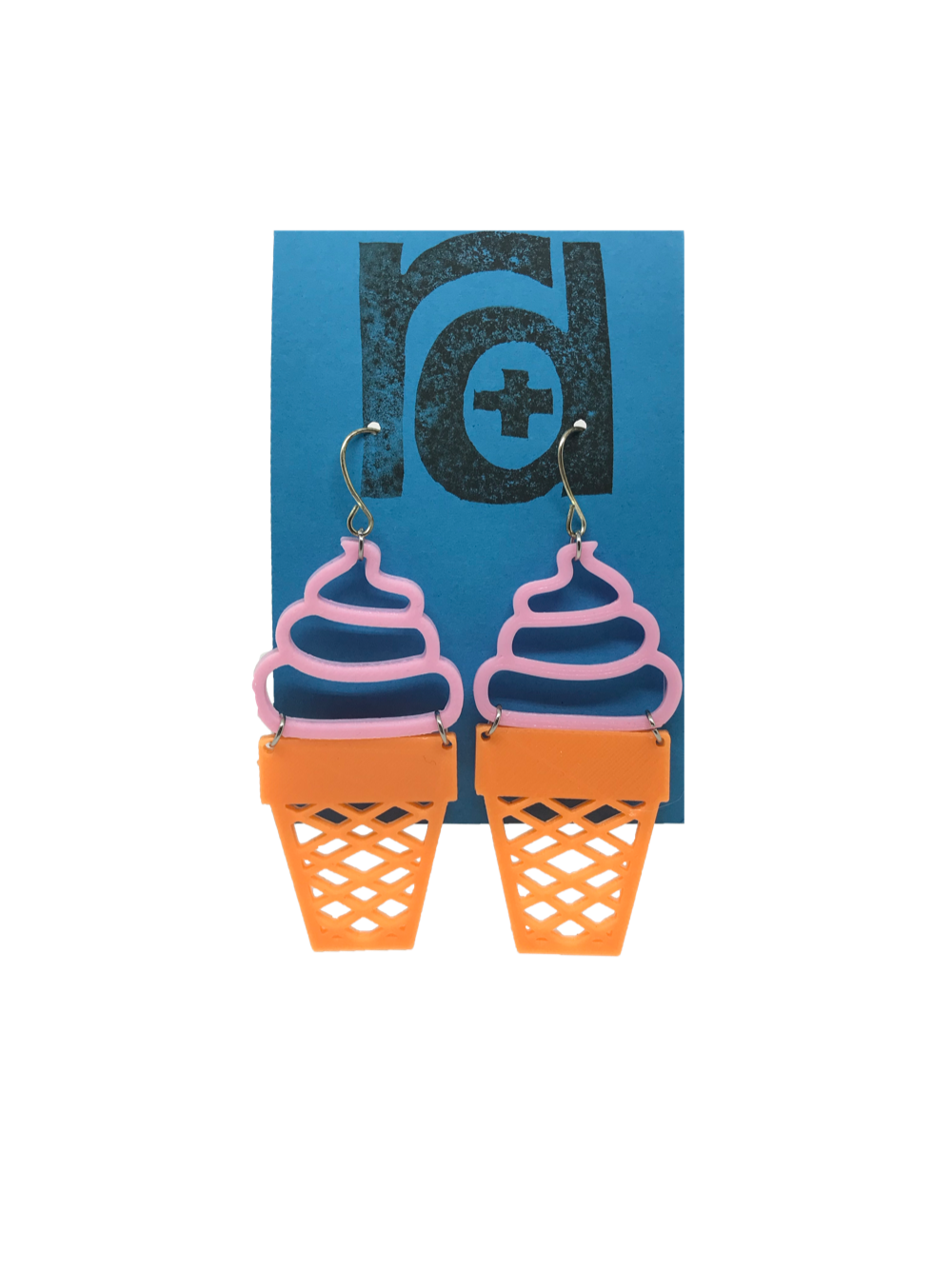 Two earrings shaped as ice cream cones; the top is a pink swirled shape like soft serve and the bottom is orange like a sugar cone.