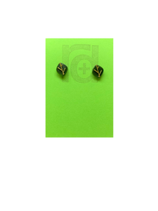 On a bright green earring card are 2 studs shaped as leaves. Each leaf is a olive green color and has veins that are gold. Not only do theres 3D printed earrings look like plants, they're made from them!
