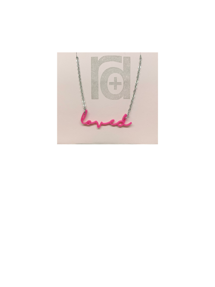 On a necklace card is a 3D printed necklace in hot pink. It is a modern cursive that says loved and can be customized to other names or words.
