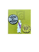 "Load image into Gallery viewer, Shown on a green R+D card are a set of three 3D printed pins. The first on the left is a white circle with a black outline and words saying ""Votes for Women"". The next is a silhouette of a woman from the 1920s. Aside from the silhouette, there is a purple sash. The third pin is a yellow rose, which was worn in support of the movement. The petals are all outlined in gold and in the center is the number 19 for the 19th amendment."