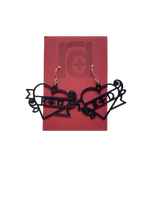 Load image into Gallery viewer, On a dark red earring card are two black R+D earrings. The earrings are shaped as hearts with a banner twisted around it and two small roses. On the banner is reads R+D, which can be personalized to say anything.