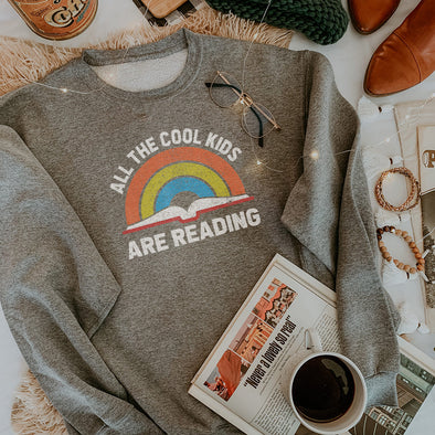 ALL THE COOL KIDS ARE READING<Br />UNISEX SWEATSHIRT  <Br />classic fit