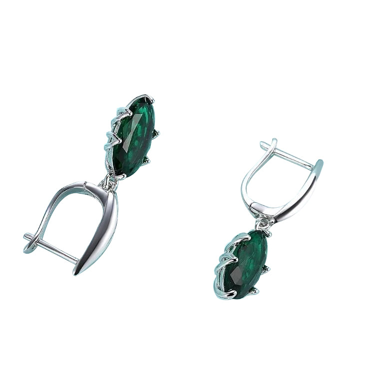 Emerald Oval Cut Earrings Set in 18K White Gold