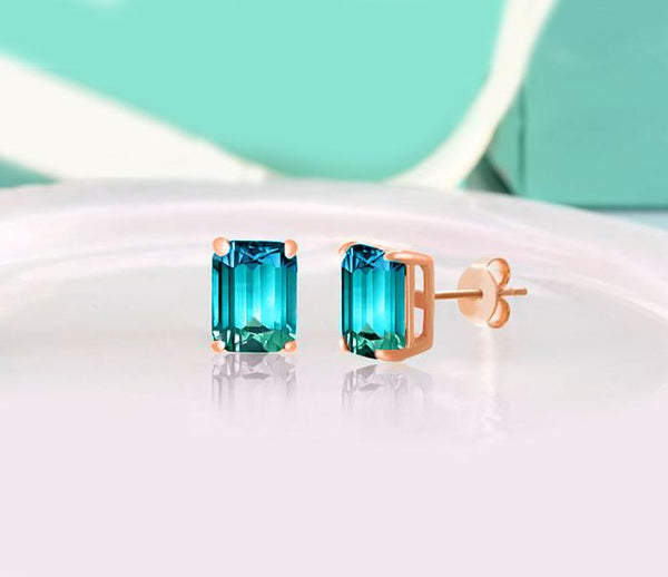 5.00 Ctw Emerald Cut White and Blue Topaz Stud Earringsin 18K Rose Gold Plated