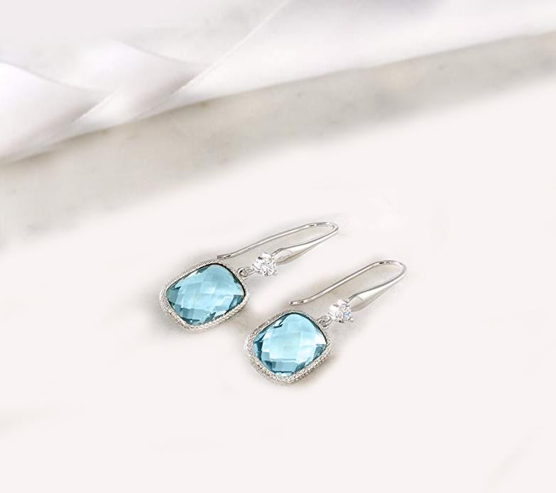 Blue Topaz Diamond Cut Drop Earring in 18K White Gold Plated
