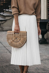 Off white pleated midi skirt styled with navy jute wedge summer heels