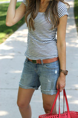Denim shorts look to style with navy espadrille wedge heels