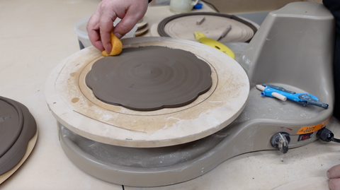 Moist sponge to smooth clay plate edges