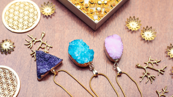 Three beautiful gemstone necklaces on a table