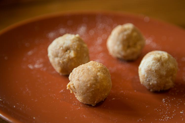 Roll the dough into four separate balls.