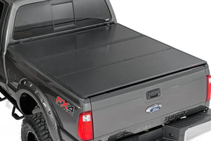 (SKU: 45599650) FORD HARD TRI-FOLD BED COVER (99-16 F-250/350 - 6.5' BED W/O CARGO MGMT)