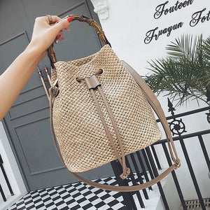 CURESOT - rattan drawstring bag with bamboo handle