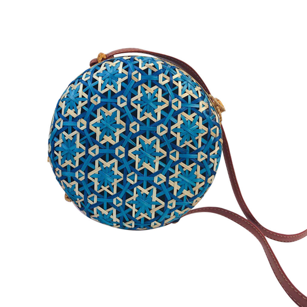 MAROC is a round straw and rattan, coloured crossbody bag