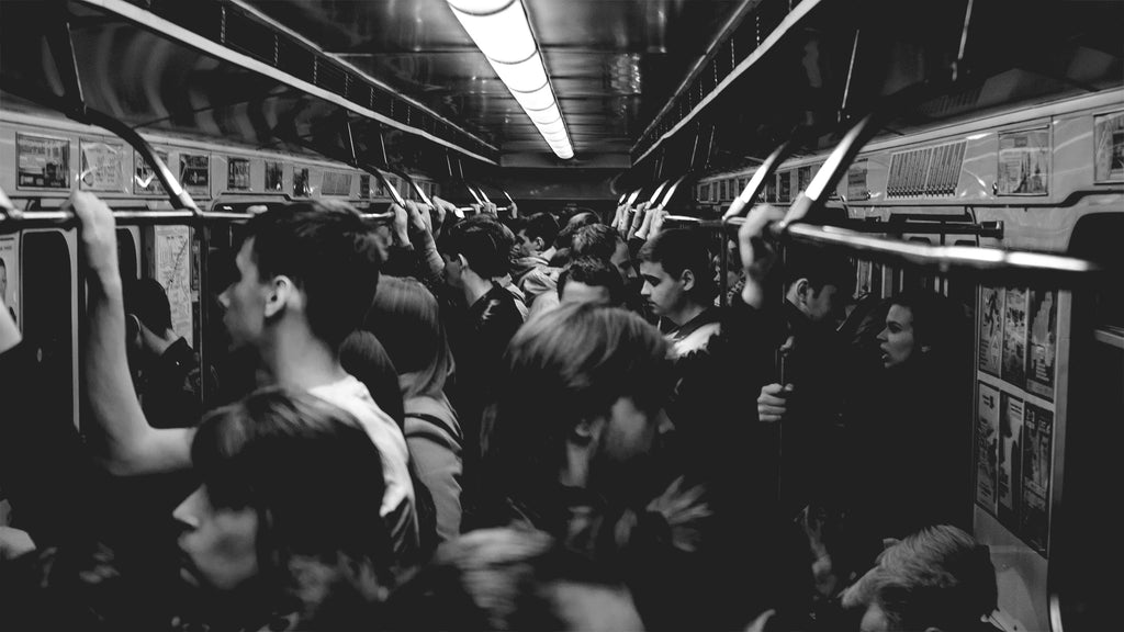 Passengers in a crowded train.
