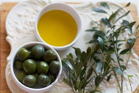 Ozonated olive oil and olives