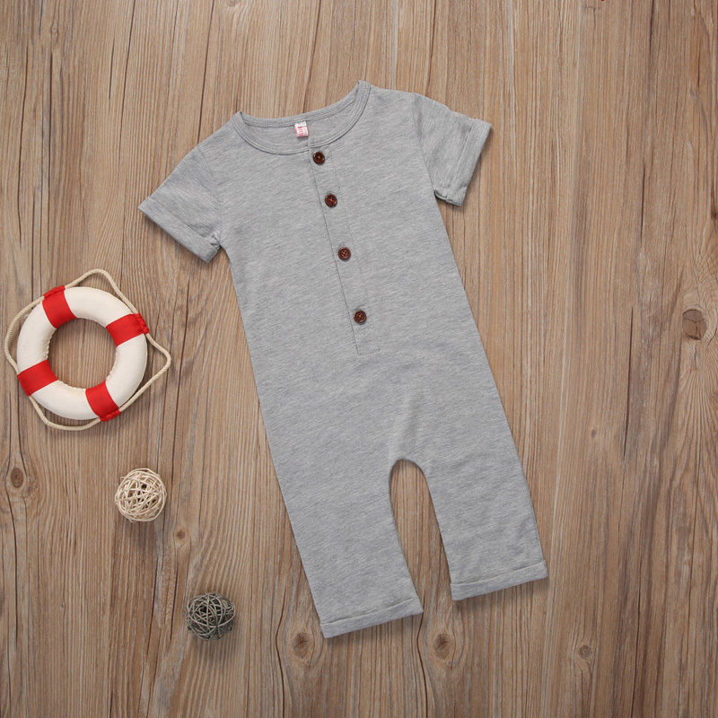 Gray rompers on wooden surface