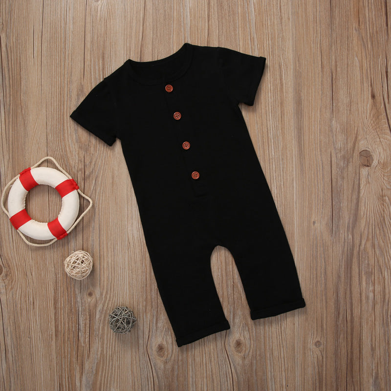 Black rompers on wooden background