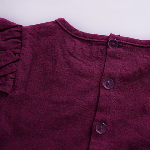 Image of Ruby romper up-close to see buttons and stitching