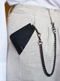 Purse on chain sitting in pants pocket