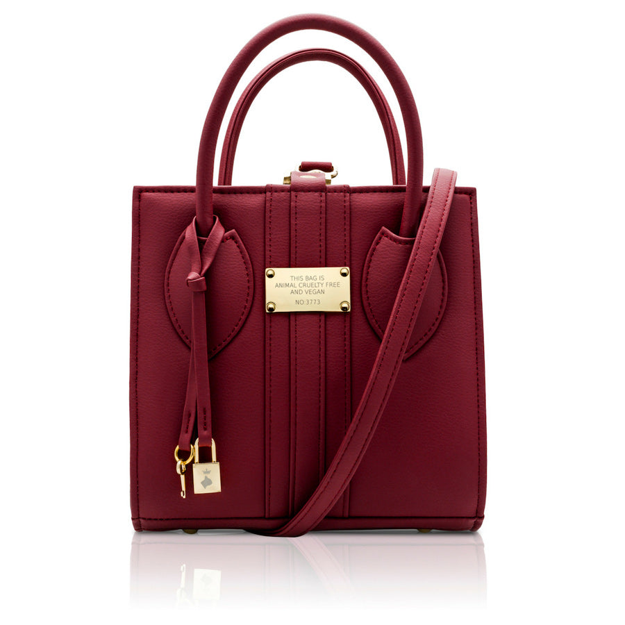 Front view of the 1.6 Mini Burgundy bag, a small square shaped red vegan tote style bag with gold hardware.