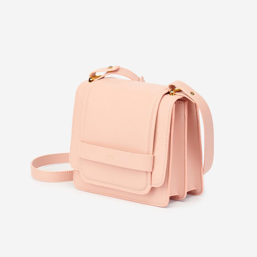 Angled view of The Fiona Bag Blush crossbody vegan bag.