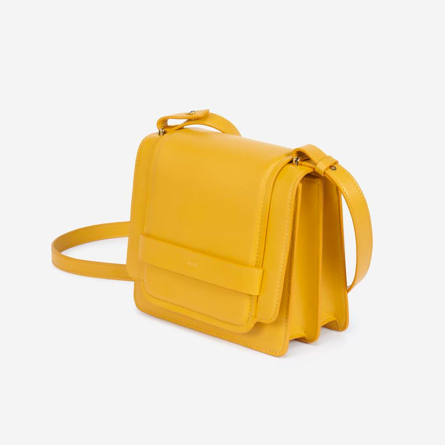 Angled view of The Fiona Bag Mustard crossbody vegan bag.