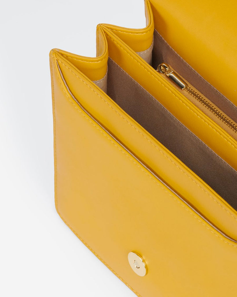 Interior view of The Fiona Bag Mustard crossbody vegan bag.