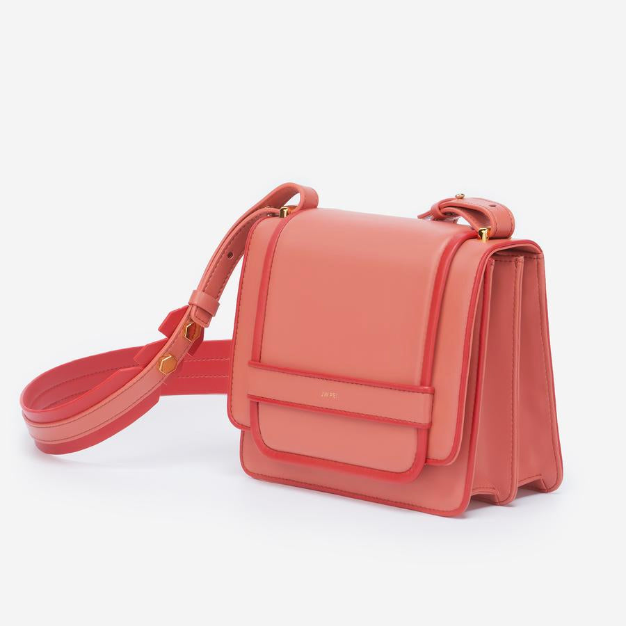 Angled view of The Fiona Bag Outlines crossbody vegan bag.