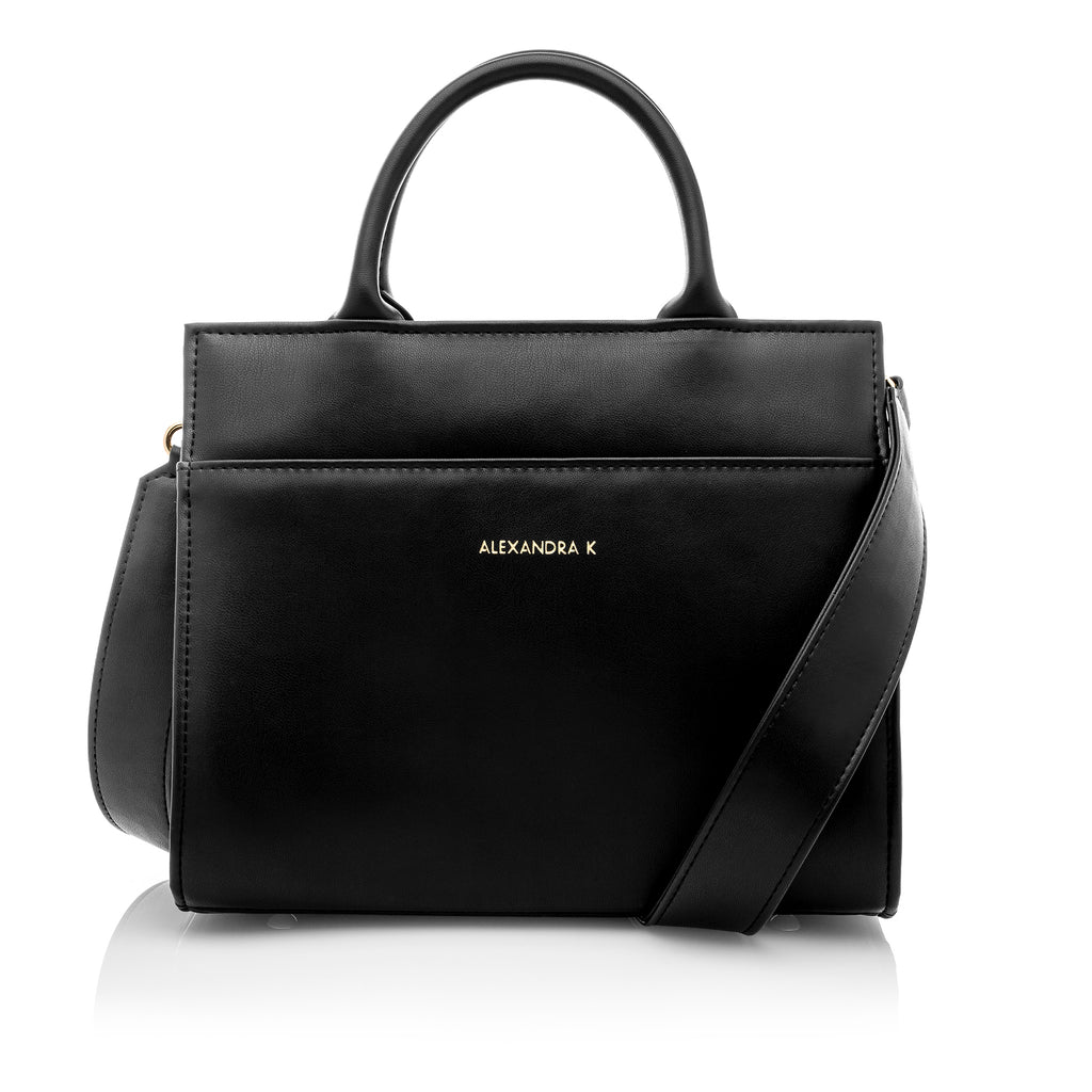 Front view of black leather look midi tote style bag with handles and shoulder strap. Gold Alexandra K branding. measures 22cm high by 25cm wide by 16.5cm deep.