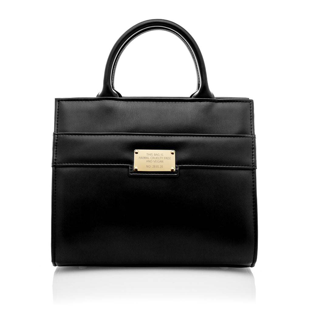 Black leather look midi tote style bag with handles. Featuring gold plaque with serial number - measures 22cm high by 25cm wide by 16.5cm deep.