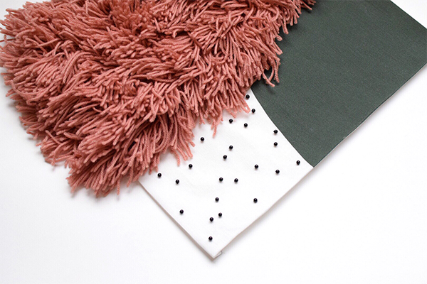 DIY fabric wall hanging with beads