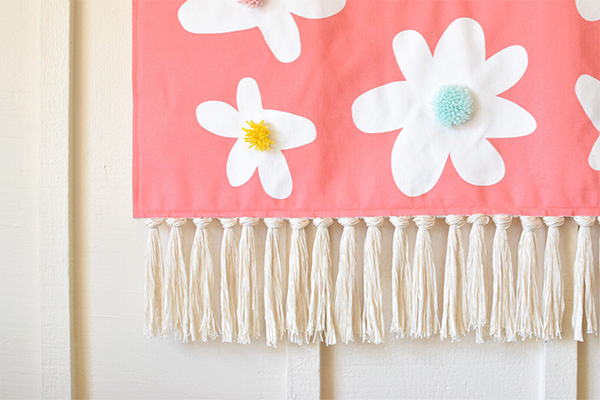 DIY fabric wall hanging with fringe