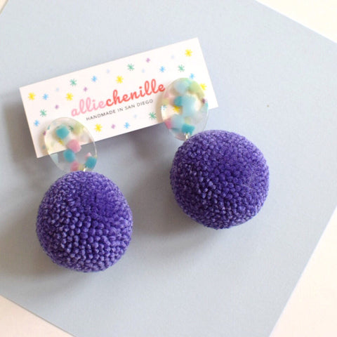 Purple pom pom earrings