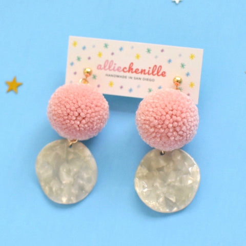 Wavy disc pom pom earrings