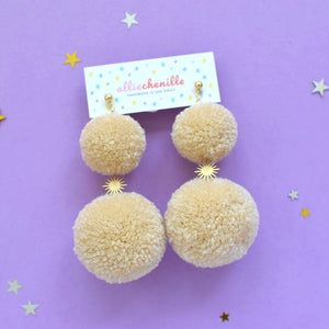 Double pom pom sunburst earrings