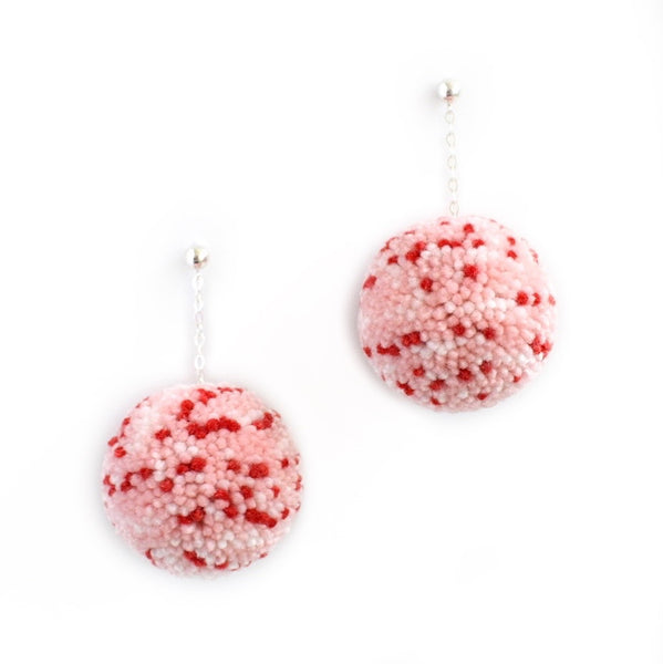 large pom pom earrings