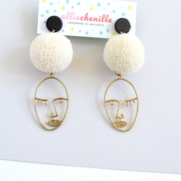 Abstract face pom pom earrings
