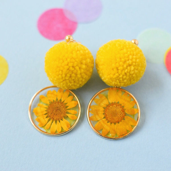 Yellow daisy pom pom earring handmade by Allie Chenille