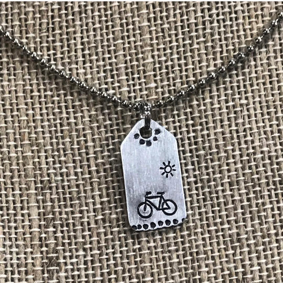 Tiny Hand Cut Metal Stamped Bicycle in the Sunshine Pendant Charm