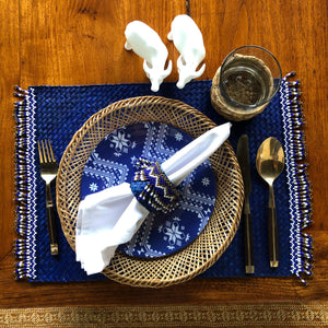 Set of 6 blue placemats with blue, white and gold beads