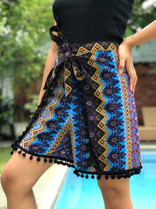 Prudence in blue wrapped around shorts with black pompoms M-XL